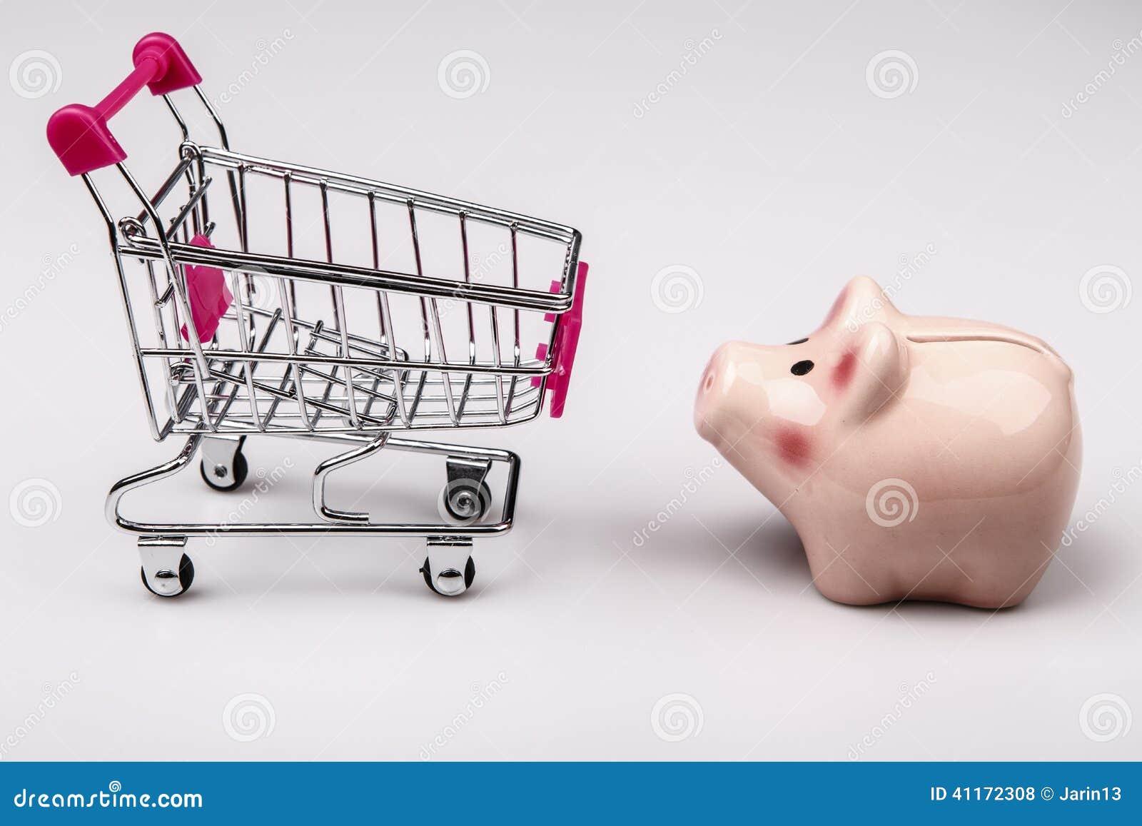 Shopping cart versus pig money box stock photo image 41172308 - Shopping cash card paying spending ...