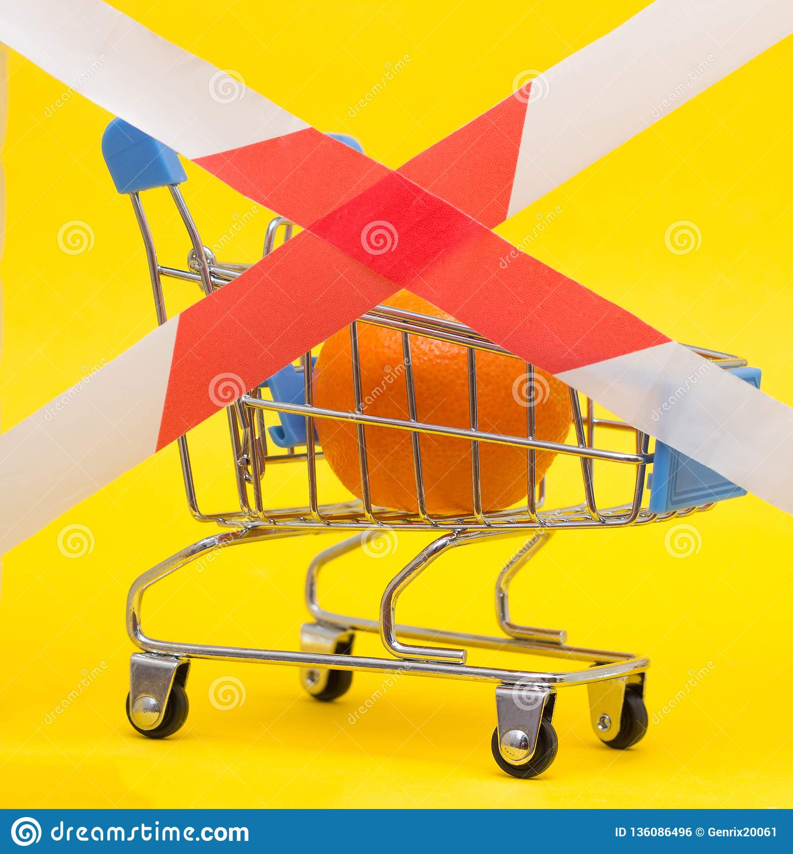 Shopping cart in which the mandarin is fenced with a banned tape, sanctions on products, prohibition, close-up
