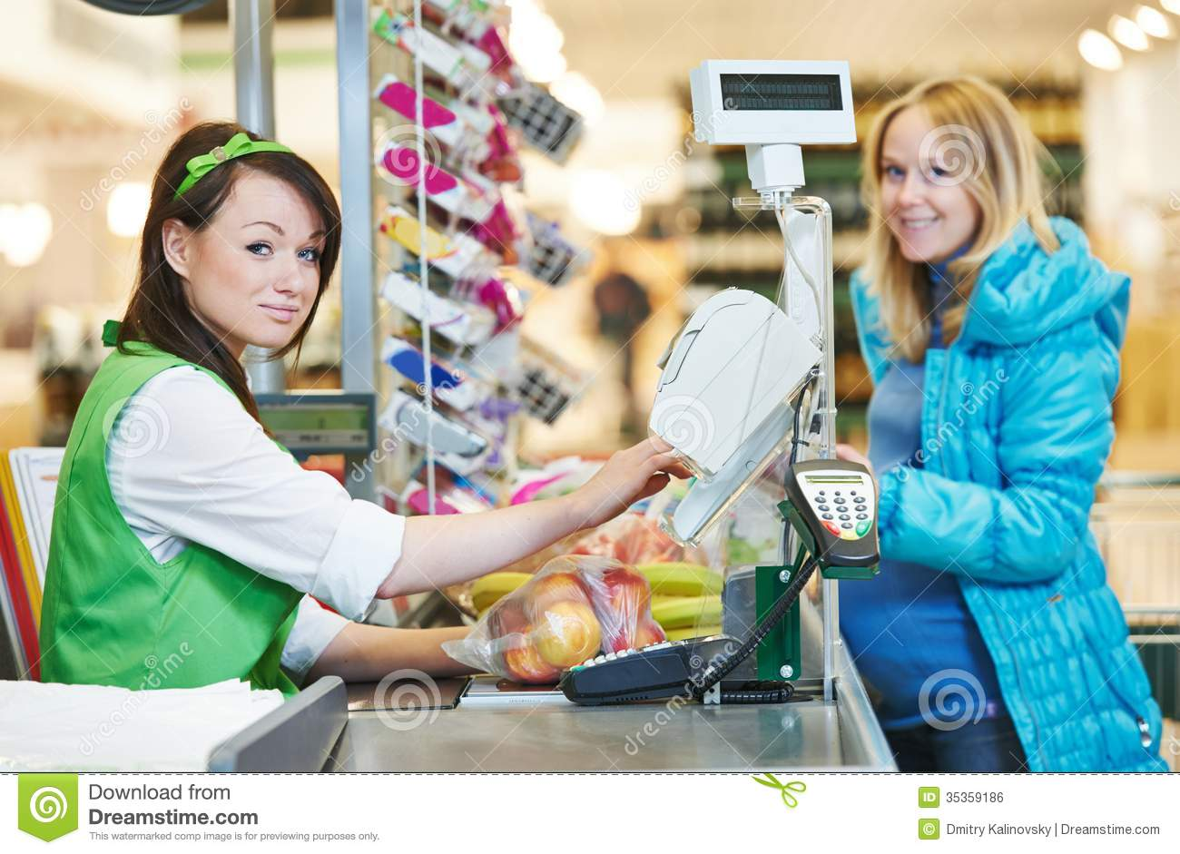Customer buying food at supermarket and making check out with cashdesk ...