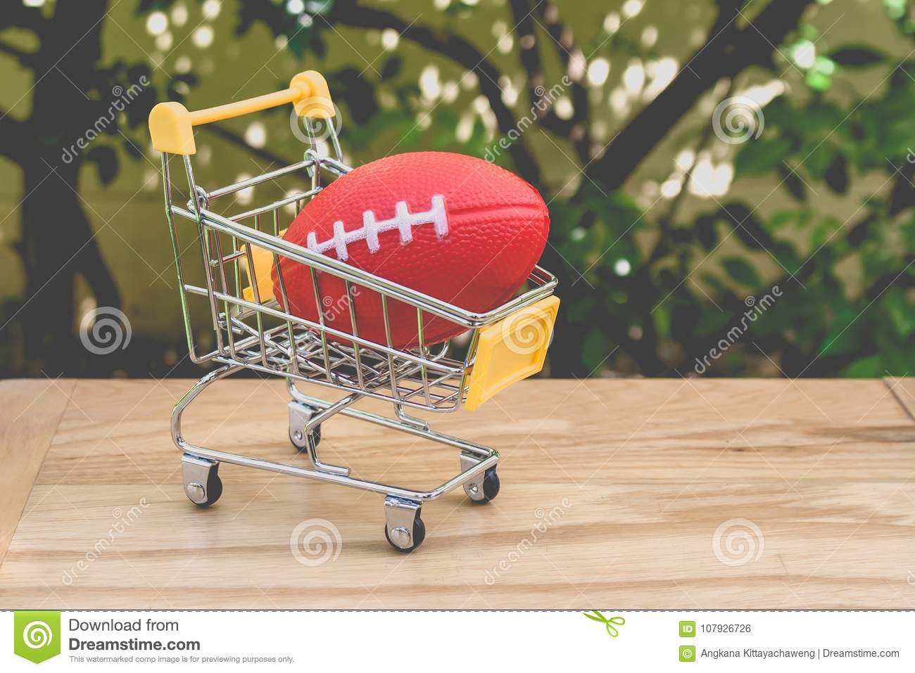 Shopping Concept Red Rugby Ball Toy For Children In Yellow Mini