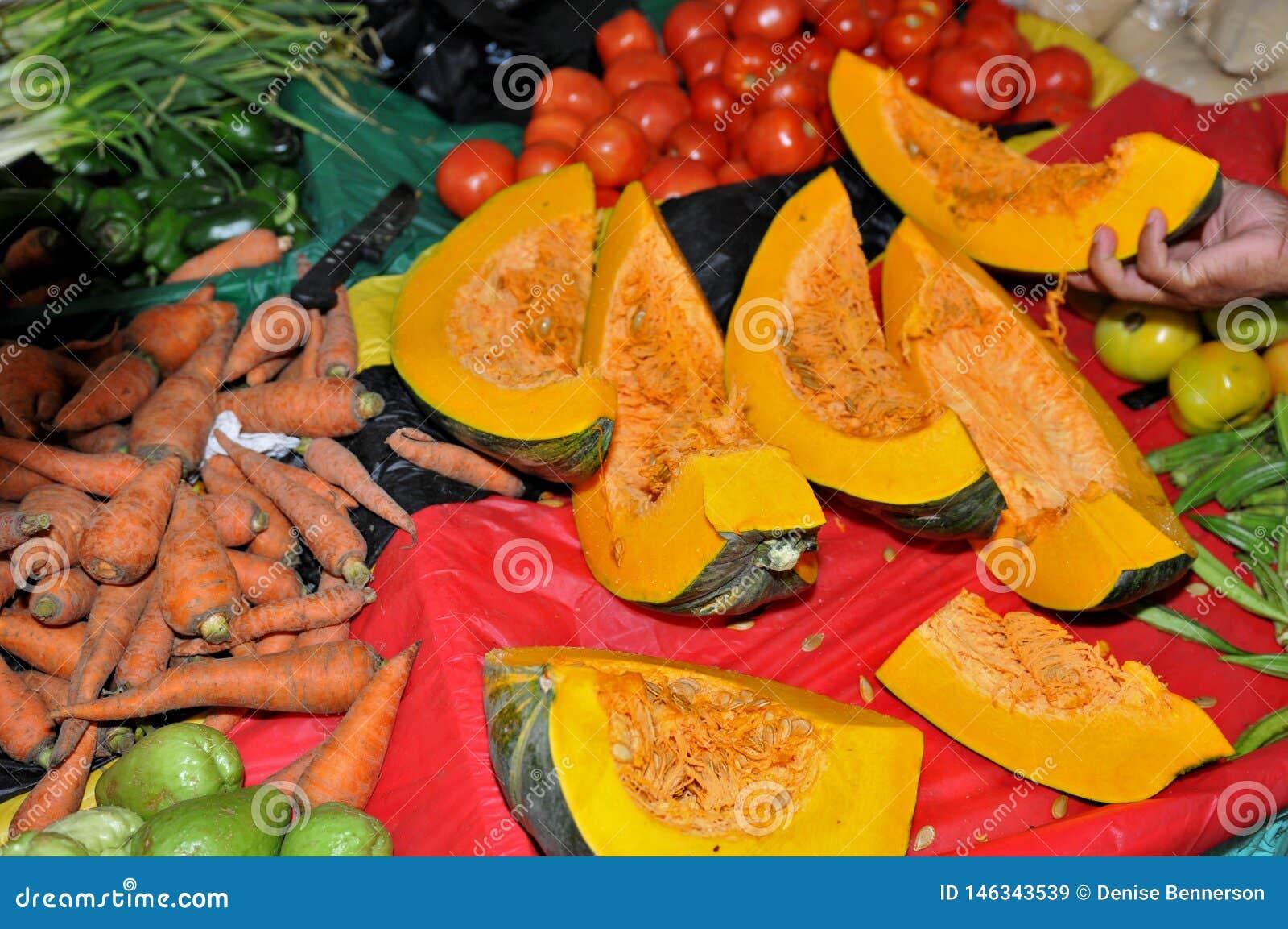 Shopping at Farmers Market Pumpkin, tomatoes, carrots and Okra