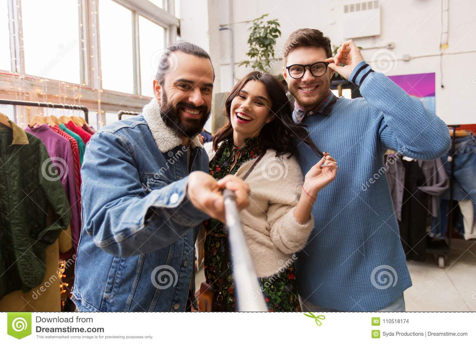Friends taking selfie at vintage clothing store