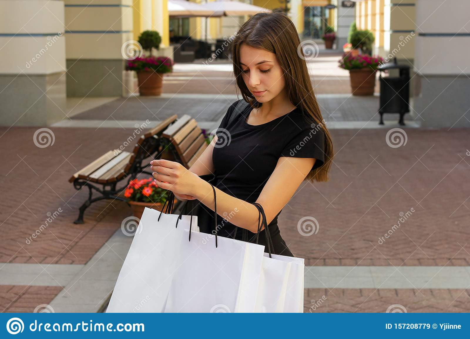 Shopping girl looking in bag sale lifestyles happiness