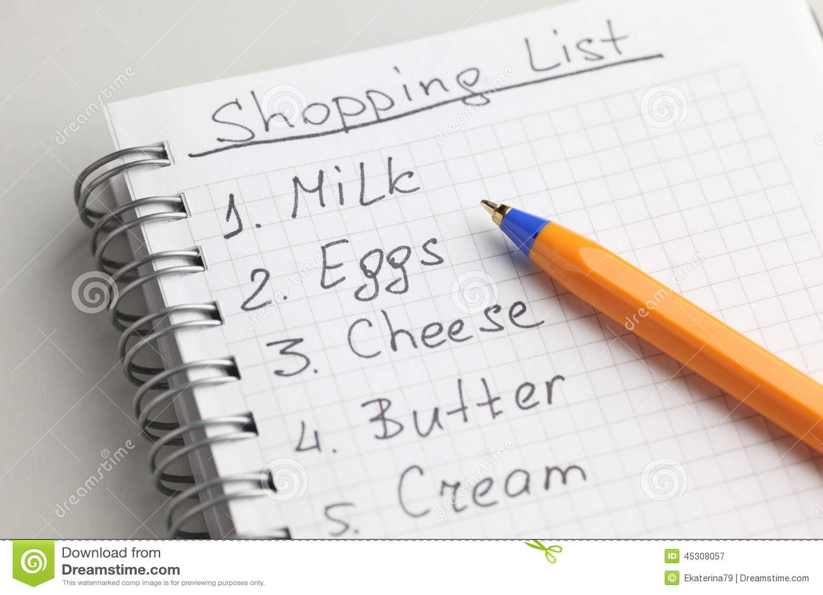 Handwritten shopping list with ballpoint pen.
