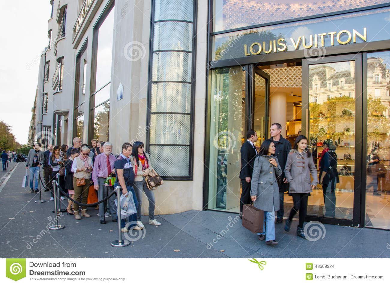 PARIS, FRANCE, OCTOBER 11, 2014 Tourists line up outside the modern Louis  Vuitton flagship store on the Champs-Elysees in Paris. 26e5d10489