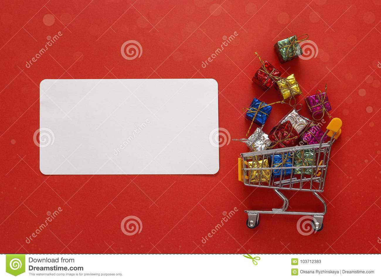 shopping trolley with gift boxes and blank label for text on red