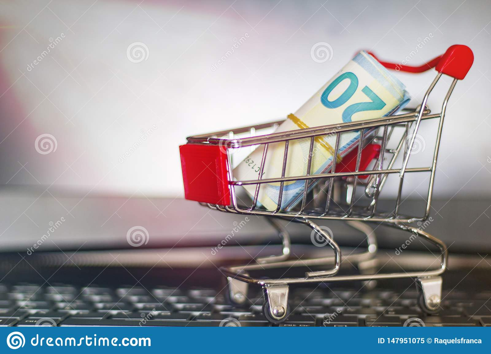 Shopping trolley on a laptop keyboard. Online shopping concept