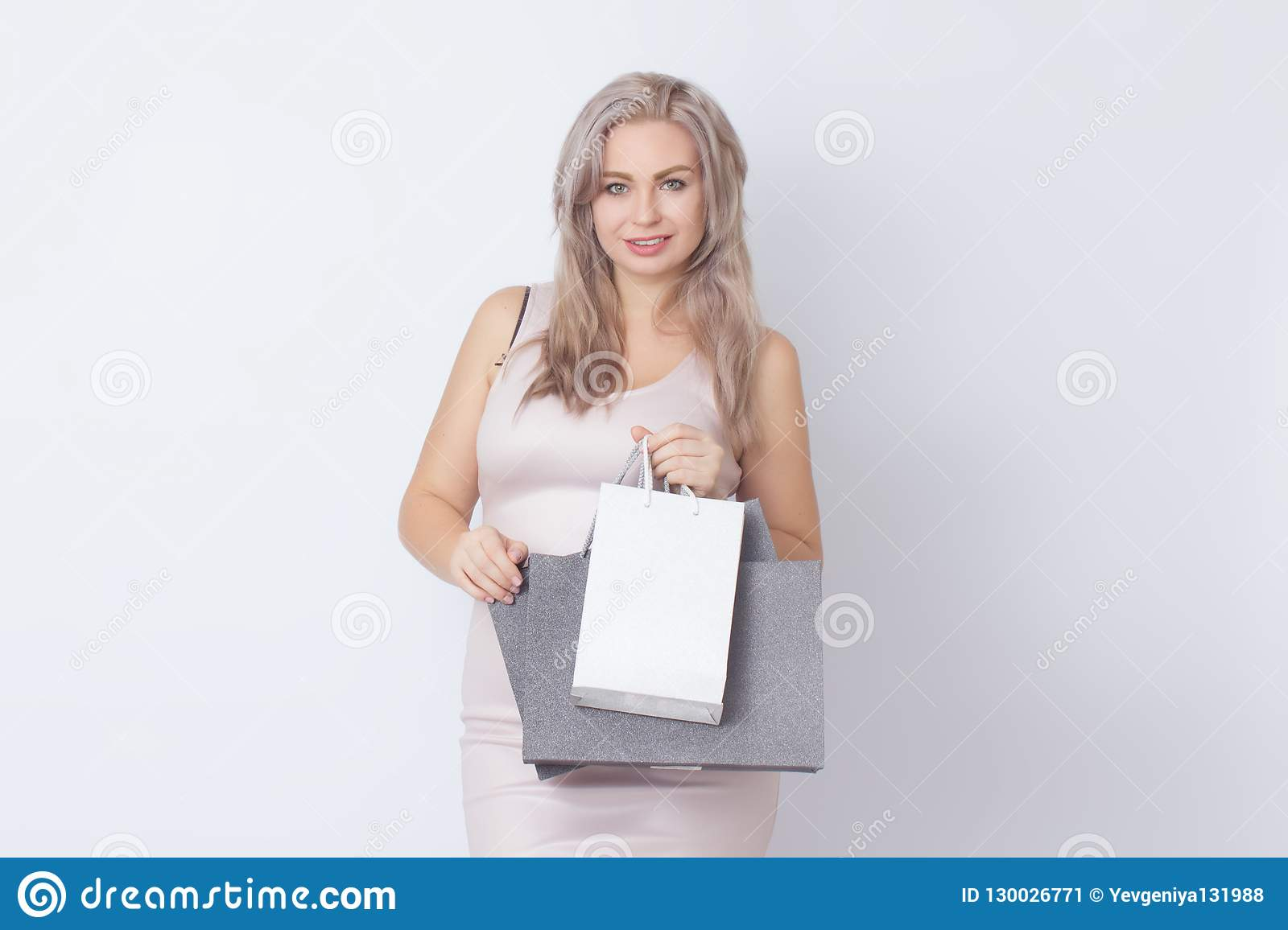Shopping woman with bags in her hands