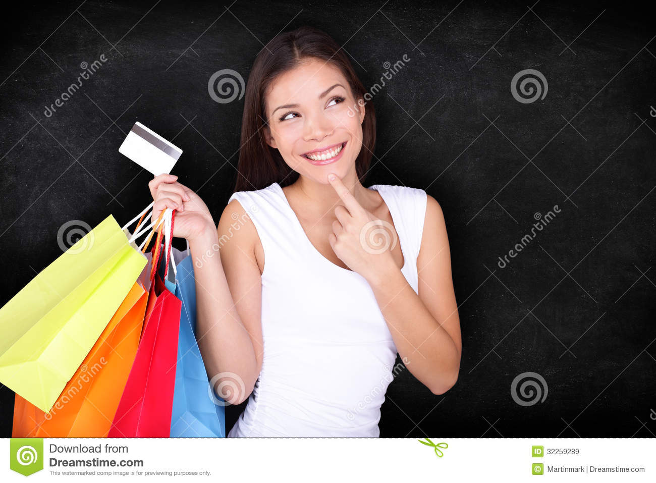 Shopping woman thinking with bags on blackboard