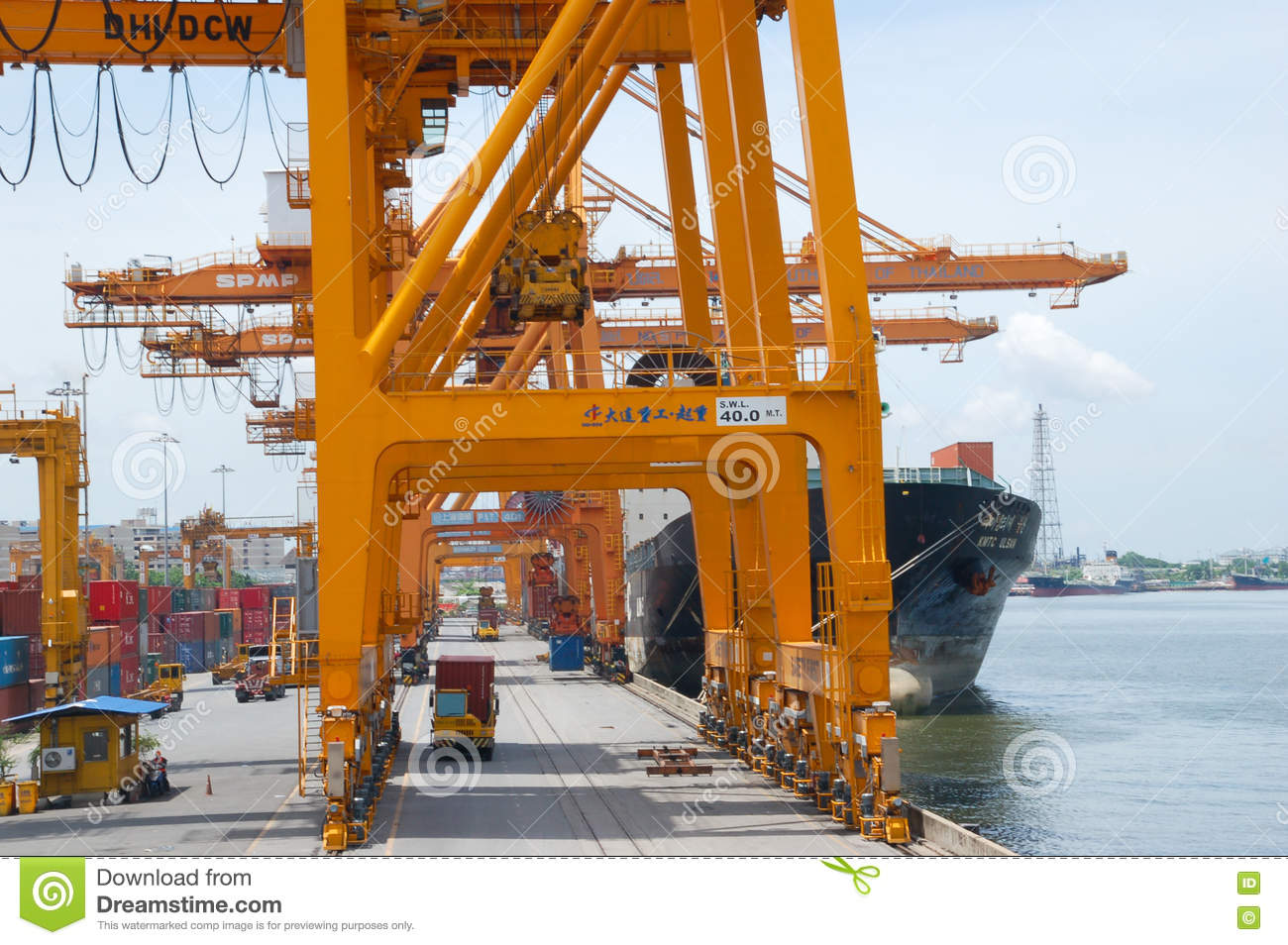 Shore Crane Loading Containers In Freight Ship Editorial