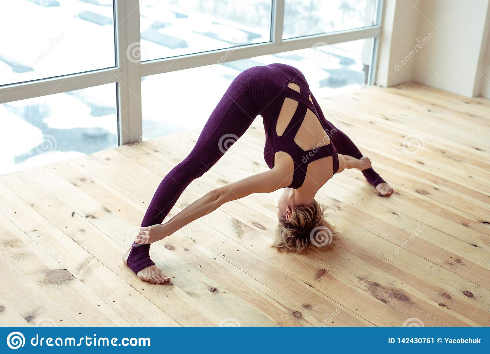 Short-haired lady being in good shape and doing yoga