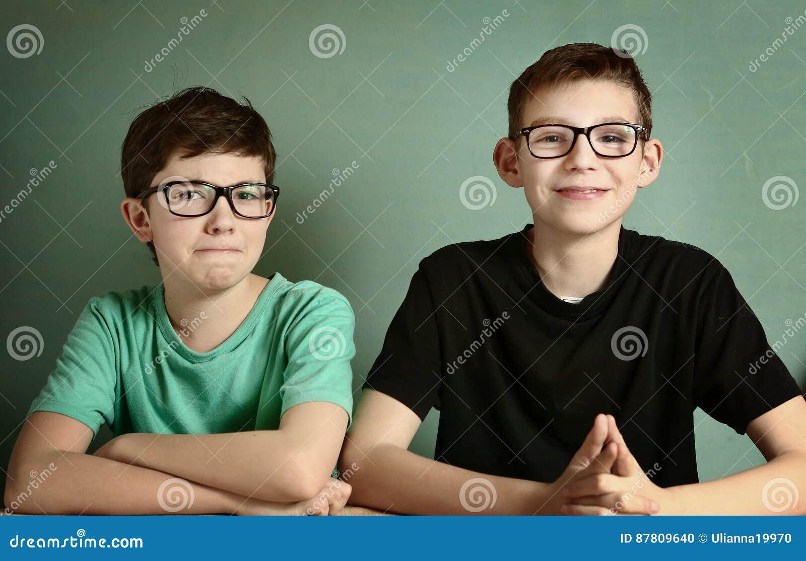 Short sighted teen boys in myopia glasses