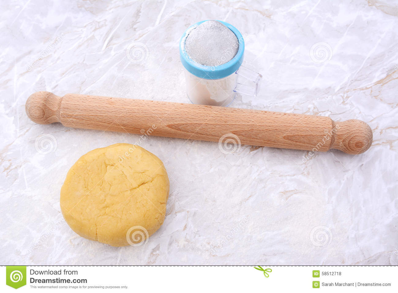 Shortcrust pastry with a rolling pin and flour drifter
