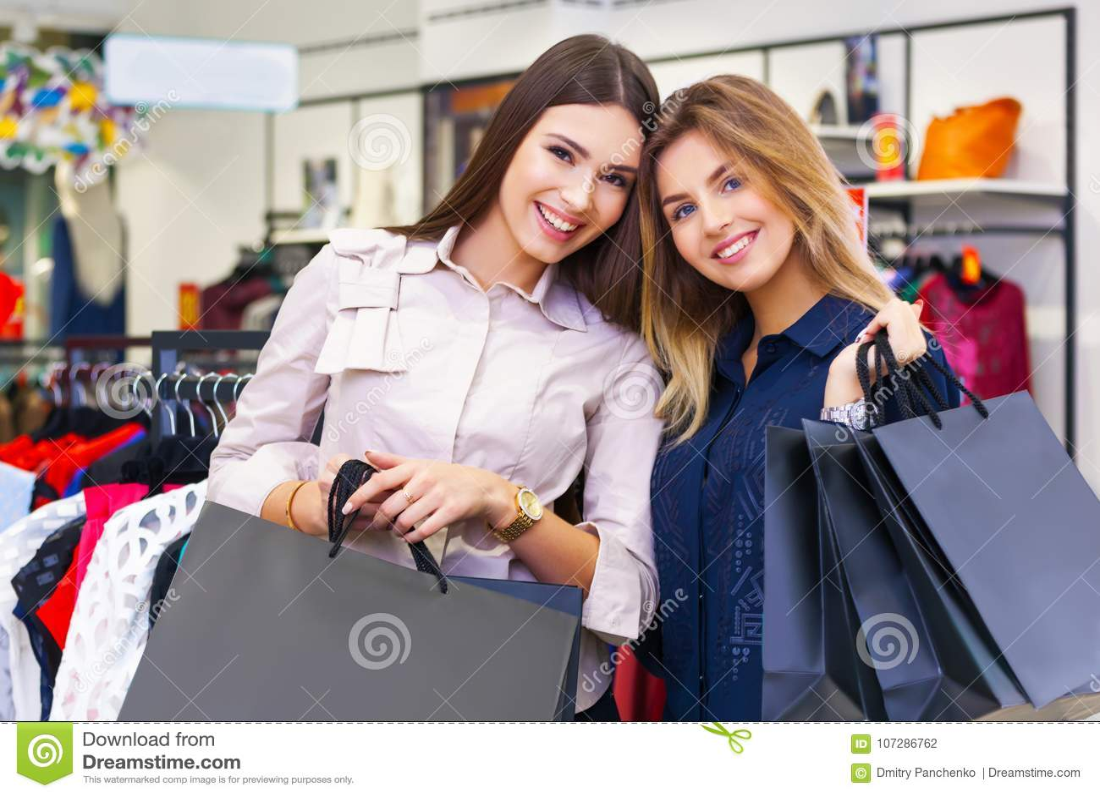 450cb8373f2 Shot Of A Beautiful Young Women Going Shopping. Stock Photo - Image ...