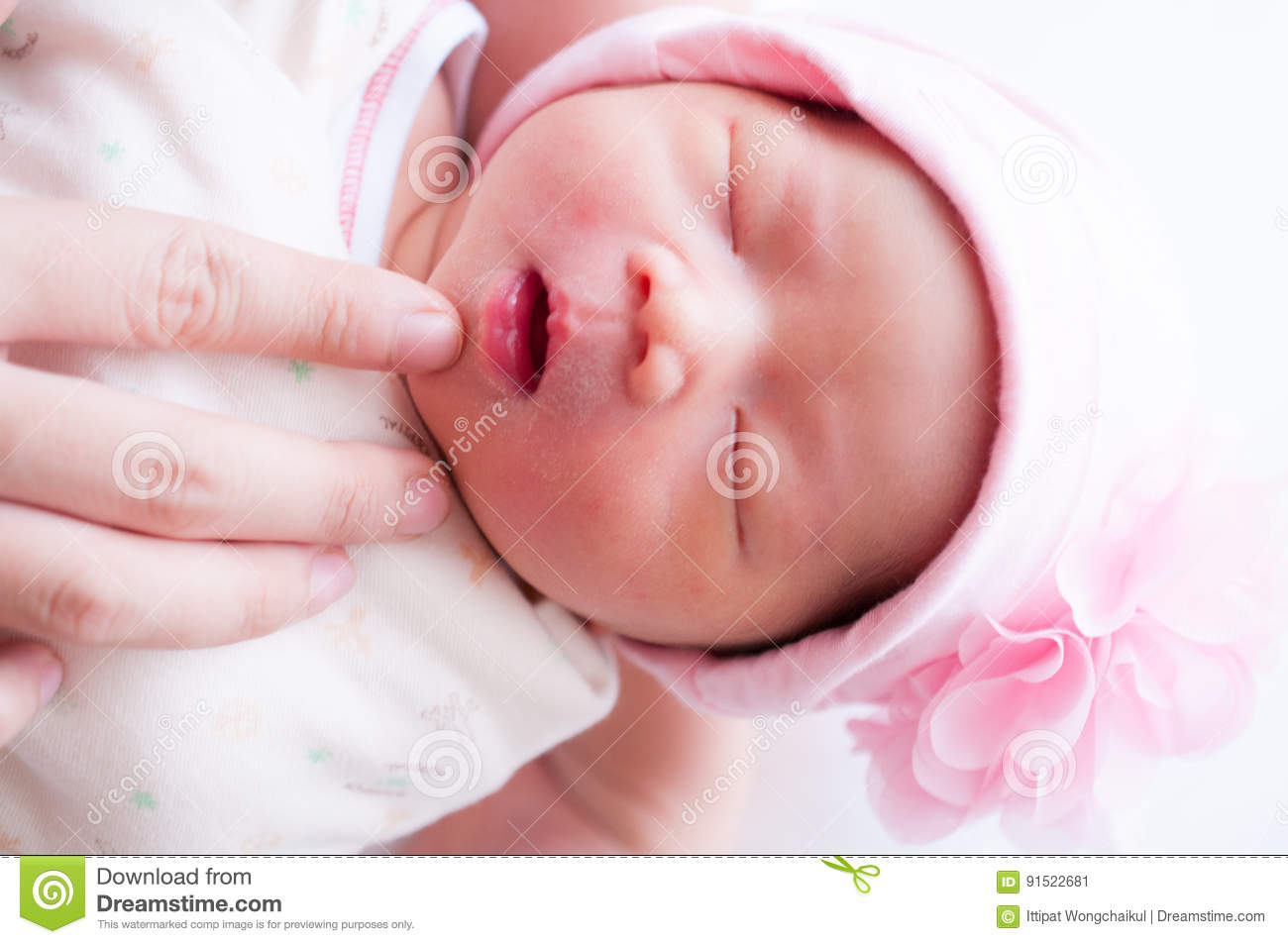 A Shot Of A Cute Baby Girl Newborn With Flower Pink Hat