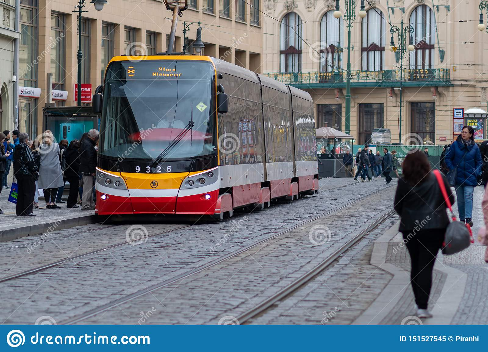 PRAGUE, CZECH REPUBLIC - 10TH APRIL 2019: Pragues new model of tram picks up customers in Spring
