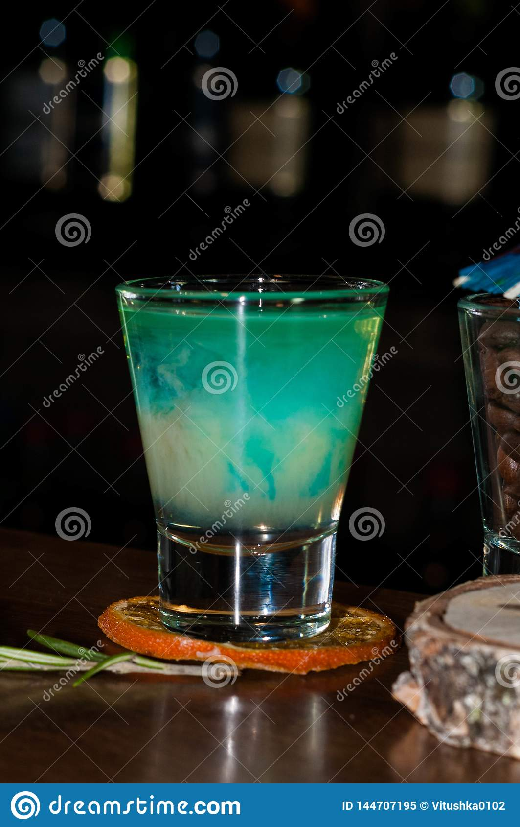 Shot glass with blue alcohol drink