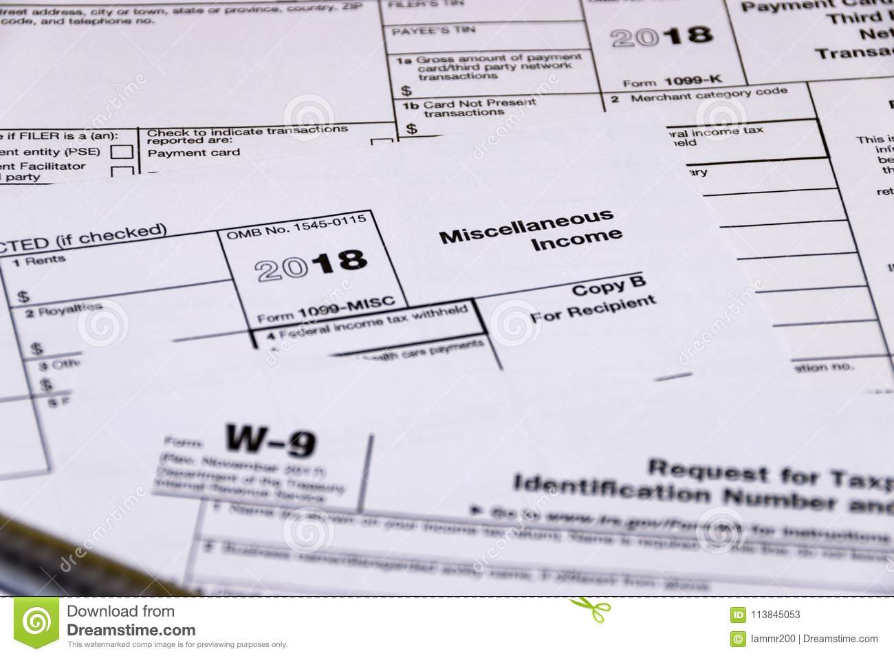 Shot Of IRS Tax Forms 1099-M, 1099-K And W-9 Editorial Stock Photo ...