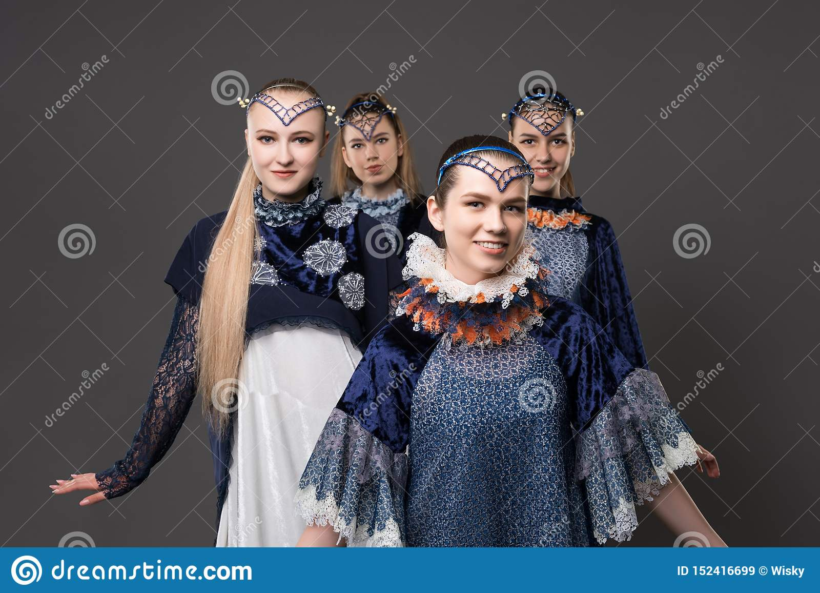 Shot of pretty girls in design dresses