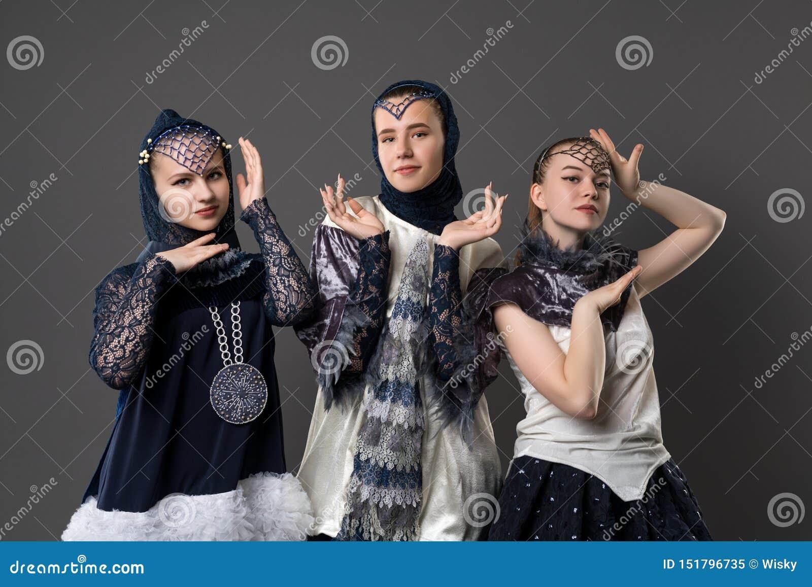 Shot of pretty teenagers in design dresses