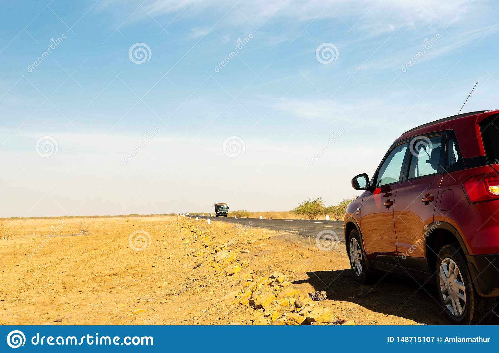 Shot Showing Red Car On A Long Stretch Of Empty Highway In