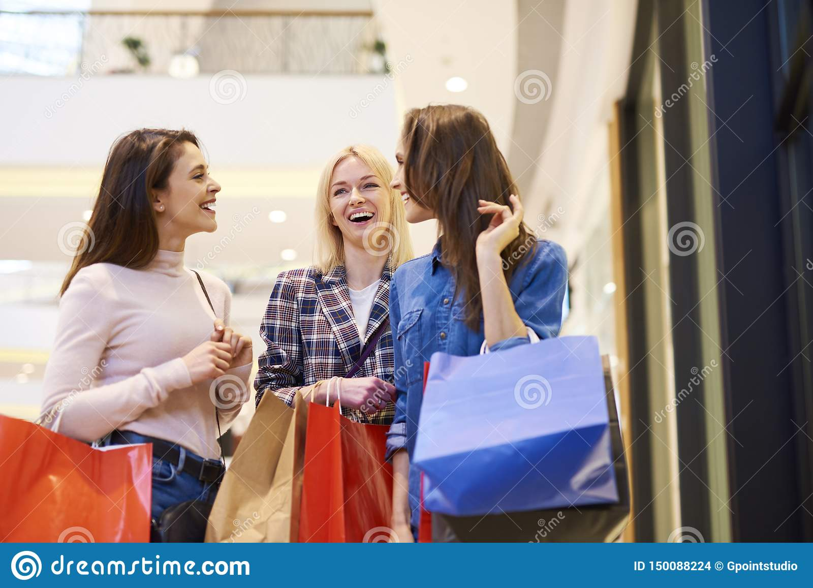 Three girls enjoying the shopping in the shopping mall
