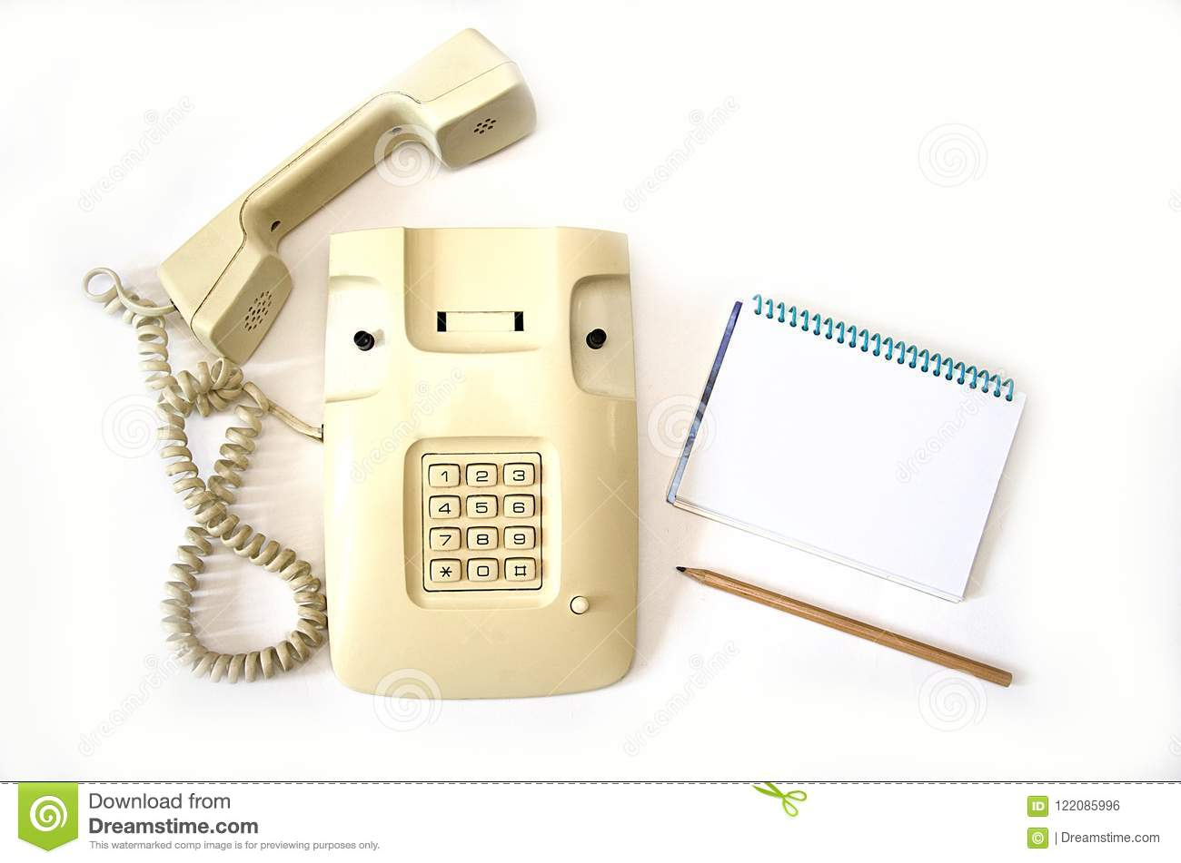Isolate Beige Old Telephone With Wire Tube Lies On White Background Handset Wiring