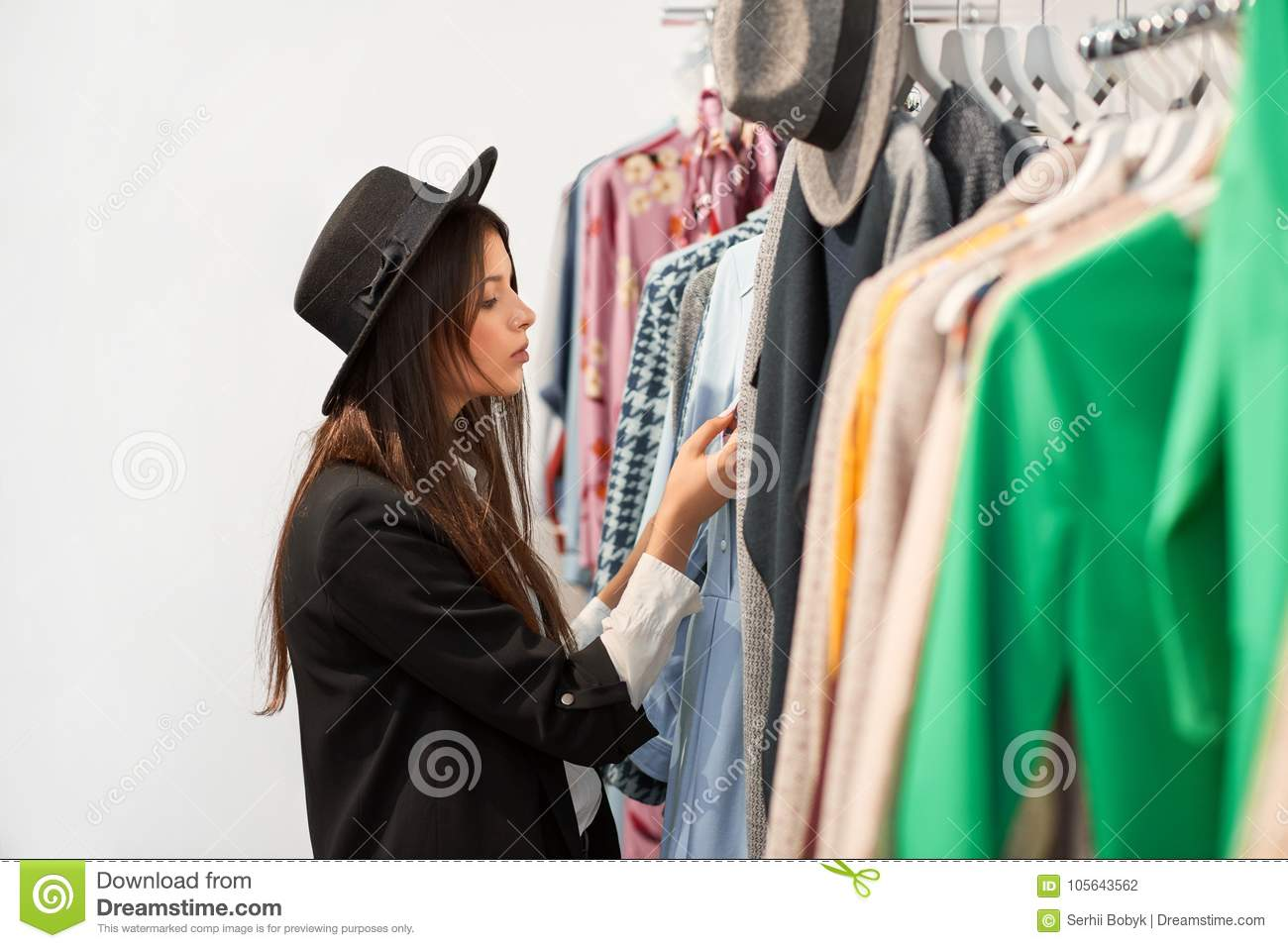 02ae3489473 Shot of a young woman examining clothing at the fashion store choosing  dresses to buy copyspace lifestyle wellbeing leisure activity beauty trendy  stylish ...