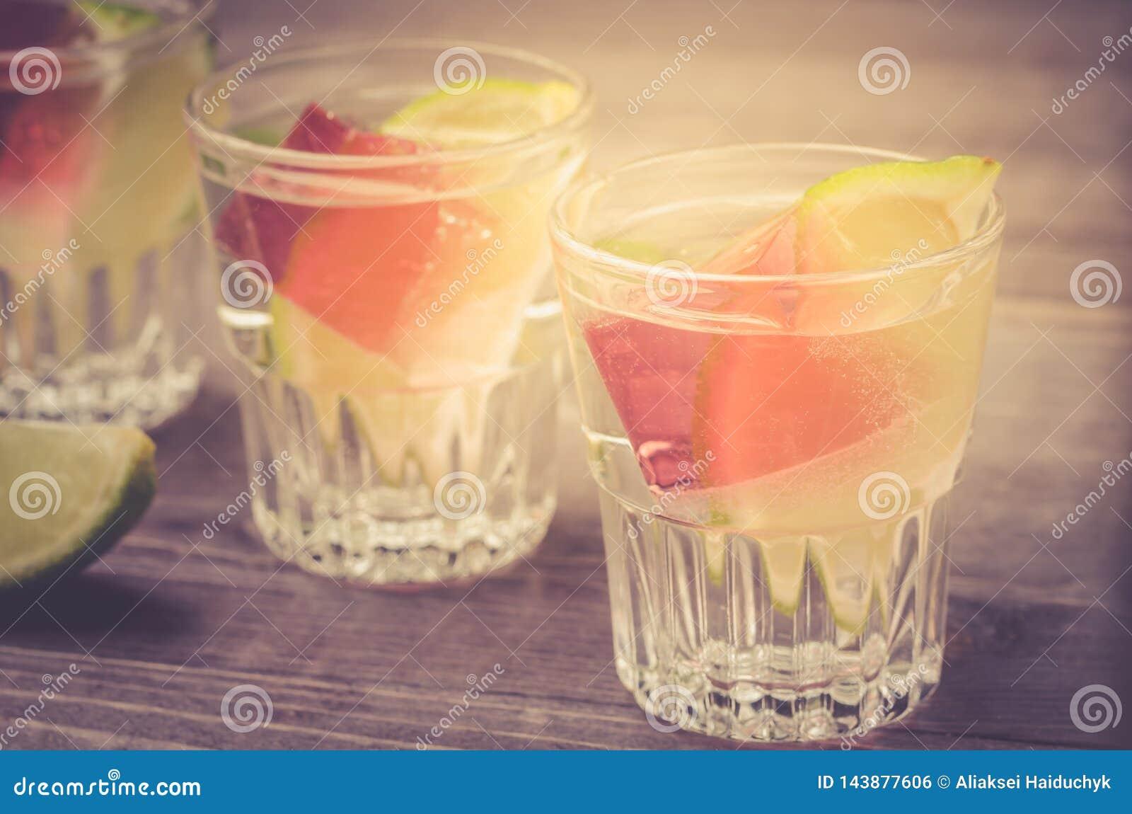 shots with ice and a lime/shots with ice and a lime. selective focus