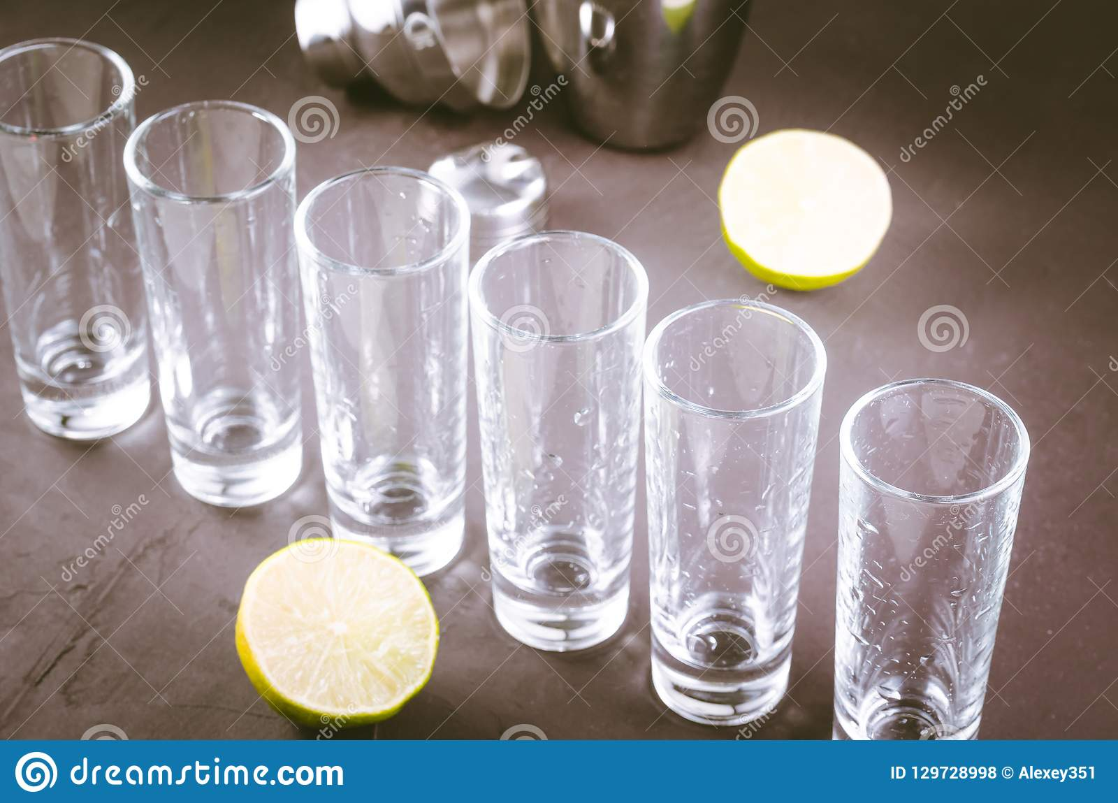 Shots ready for alcohol on bar/shots ready for alcohol and lime