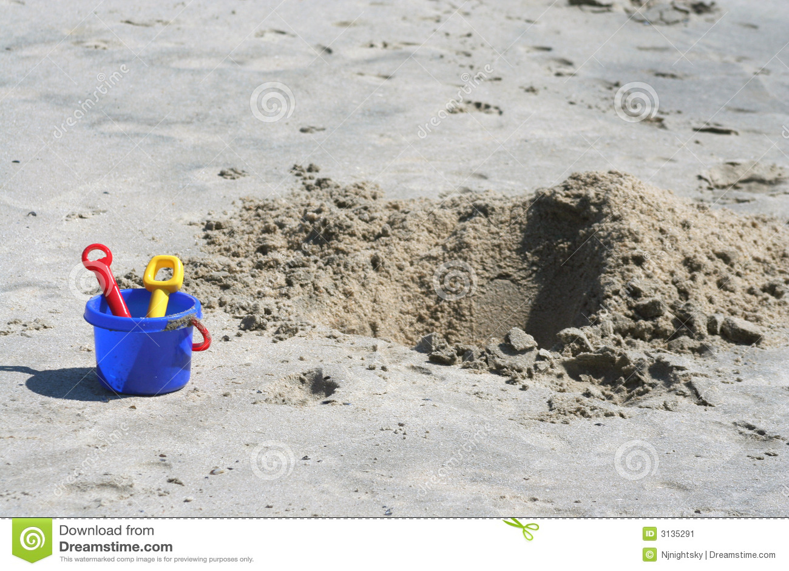 Shovel, pail and sand pit