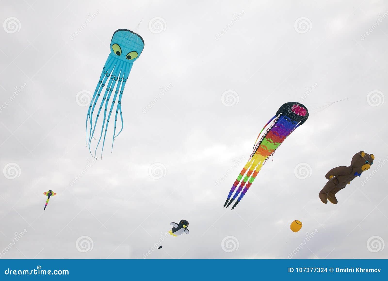 Show of kites against background of light sky