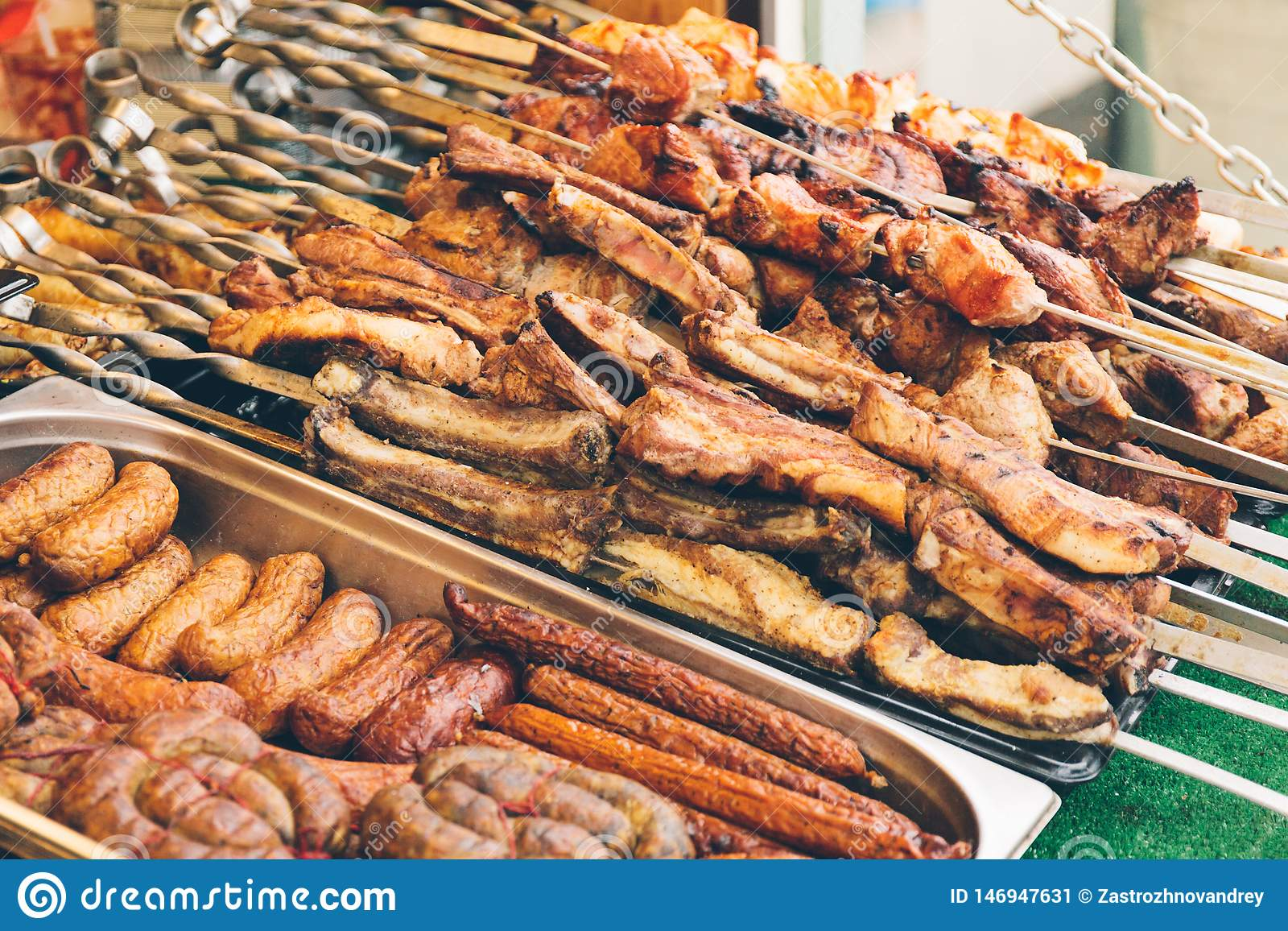 Showcase of street food with sausages, sausages and shish kebab