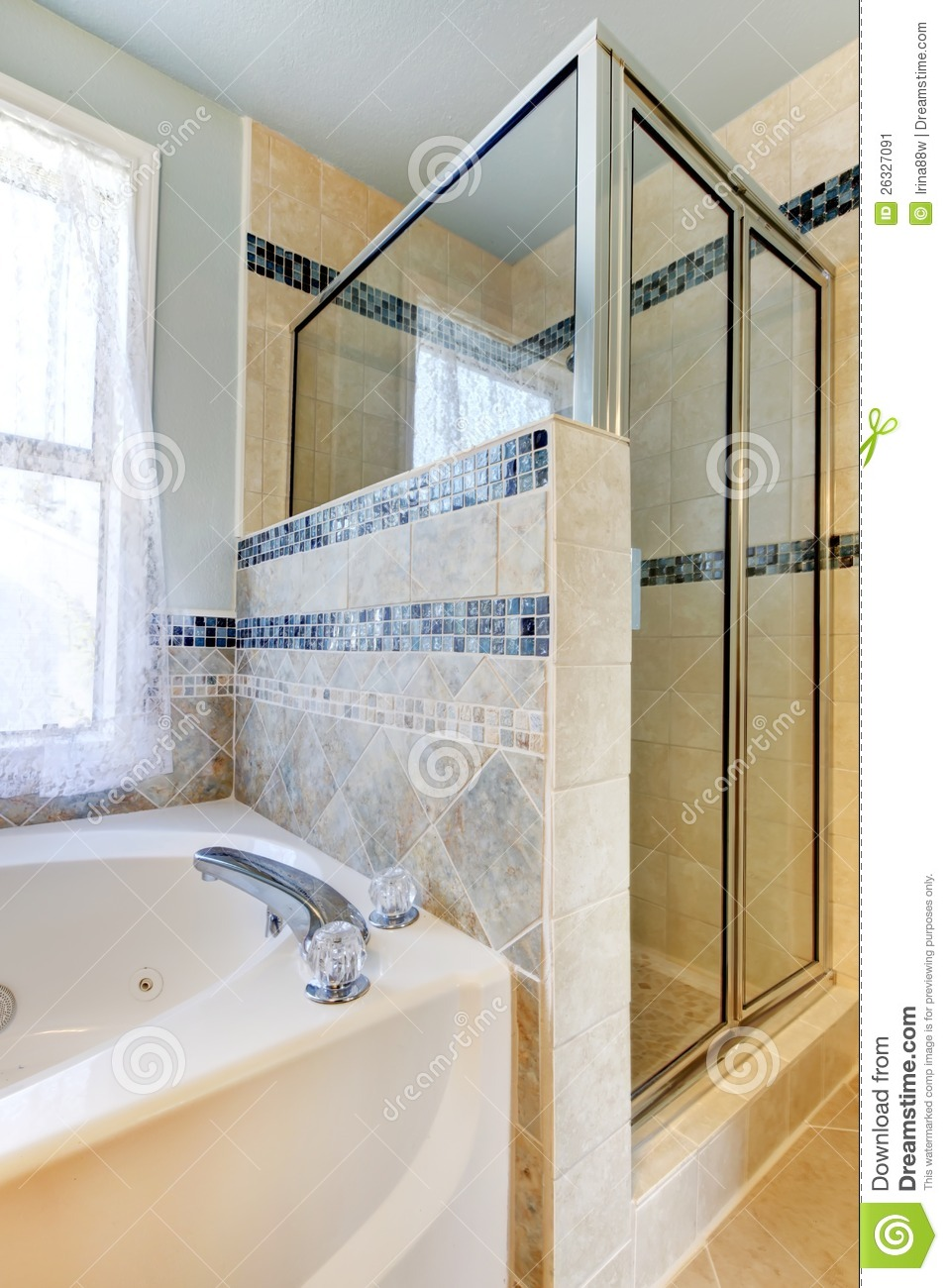 shower with beige and blue tiles and white tub stock. Black Bedroom Furniture Sets. Home Design Ideas