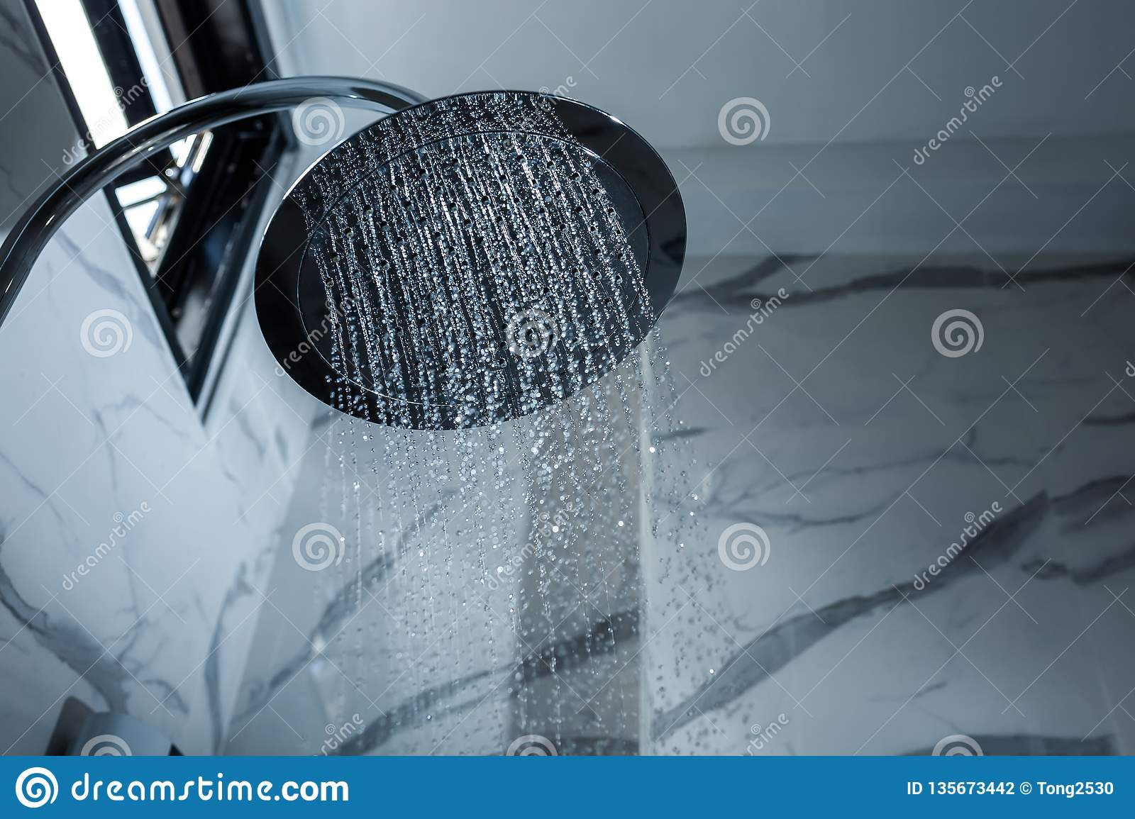 [shower head] shower head in bathroom with water drops flowing