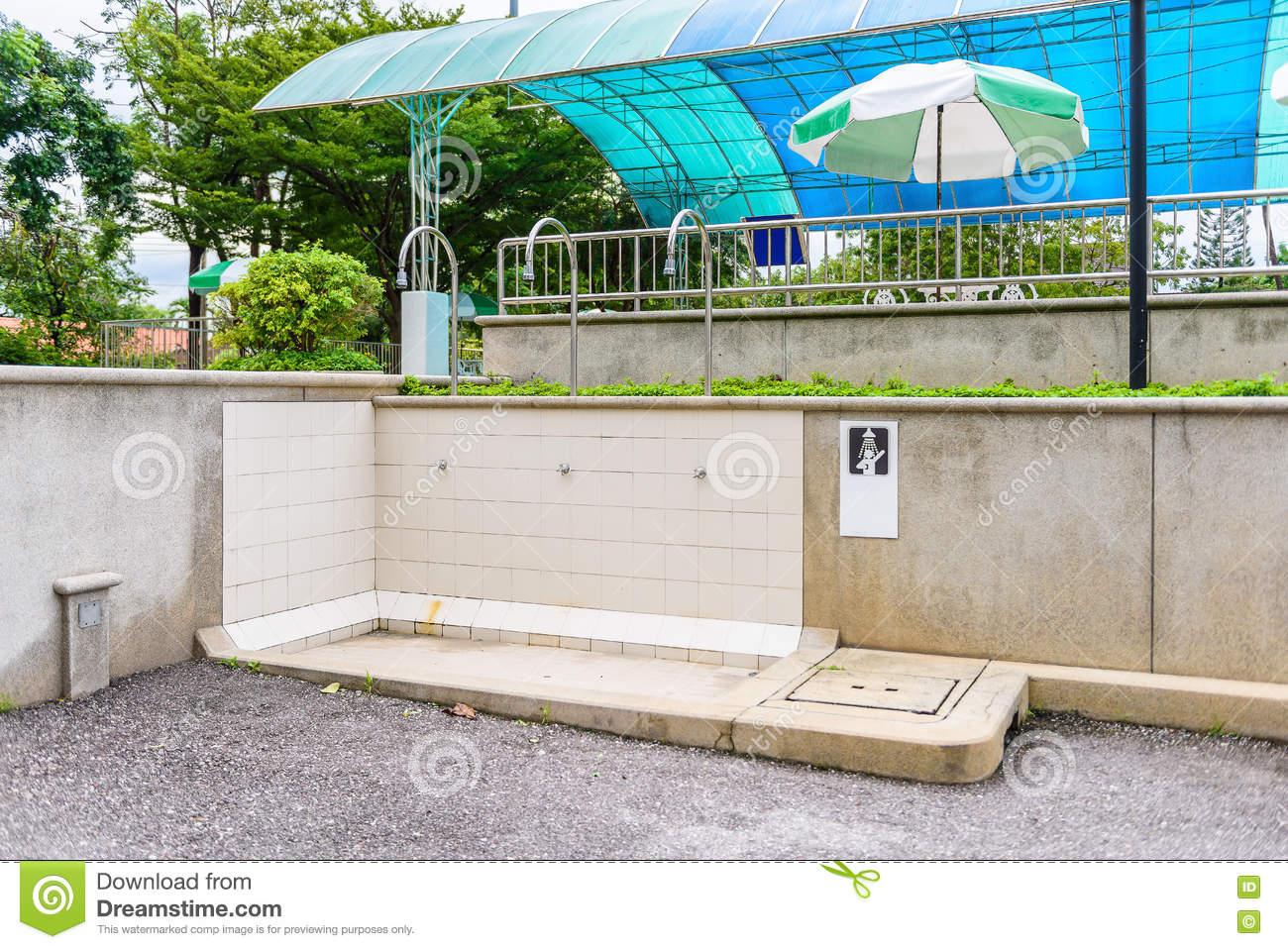 shower heads and faucets in outdoor washing area stock photo