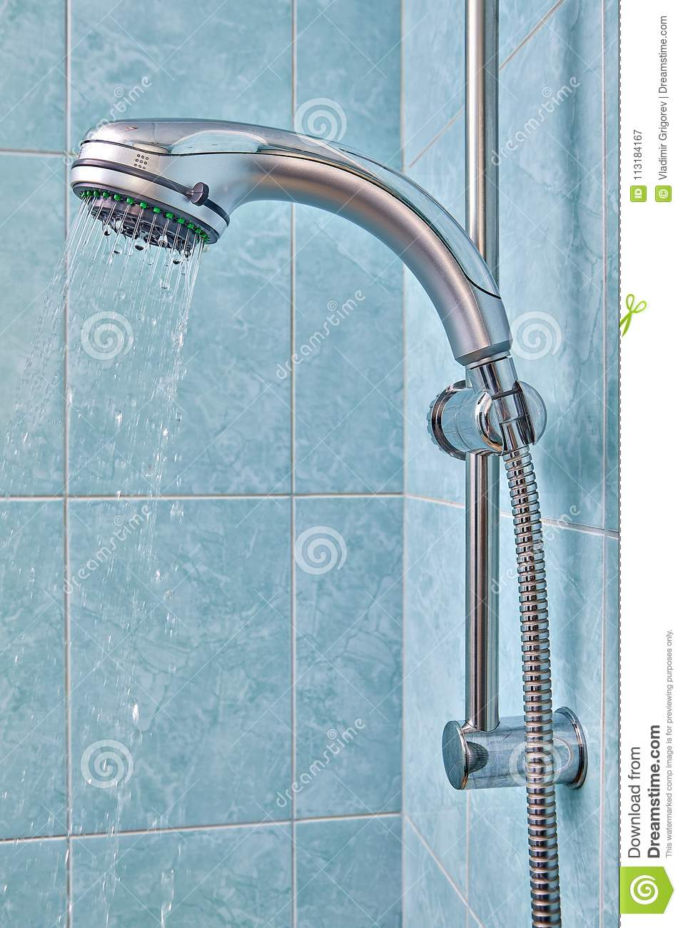 Shower Holder With Flexible Hose In The Bathroom, Water Flows. Stock ...