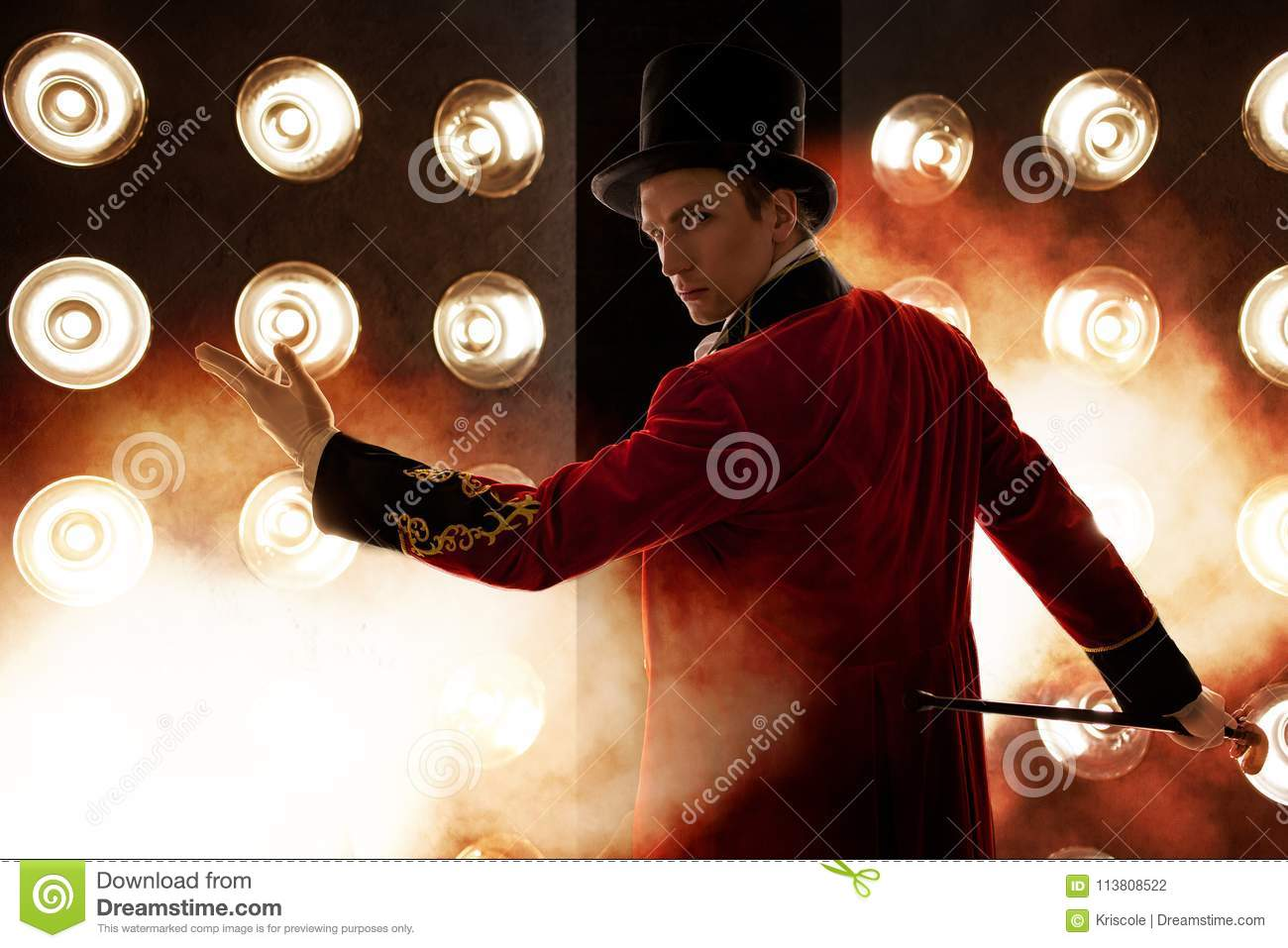Showman. Young male entertainer, presenter or actor on stage. The guy in the red camisole and the cylinder.