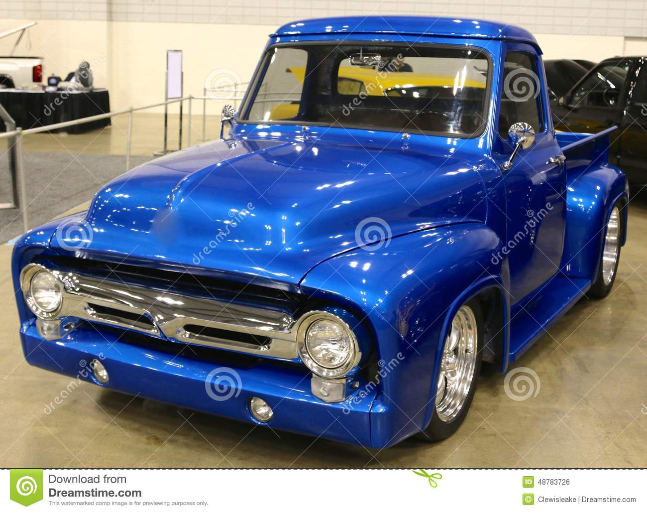 showroom condition antique blue ford pick-up truck. editorial