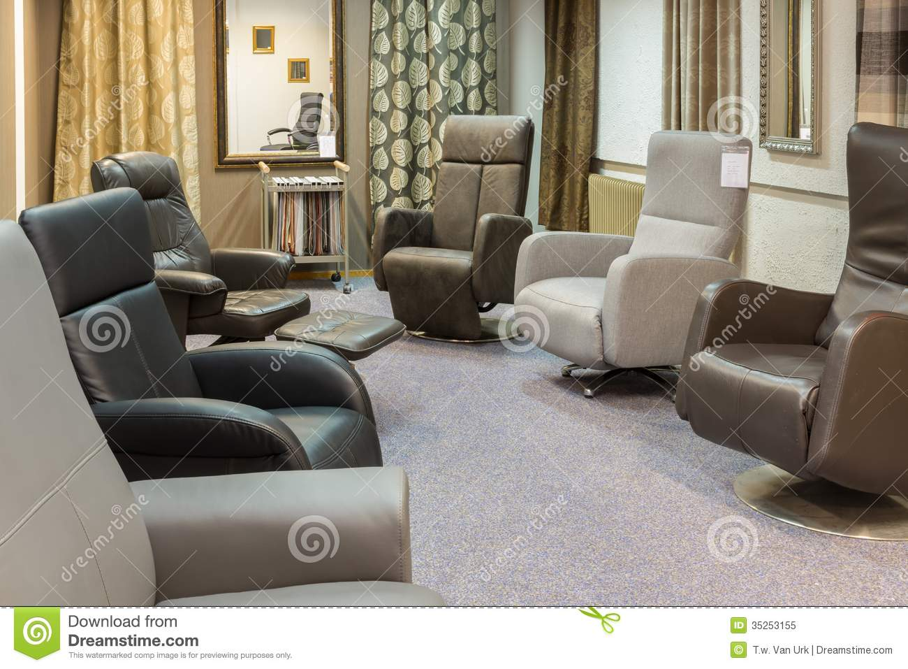 Showroom of modern furniture store with luxury armchairs for Modern furniture warehouse