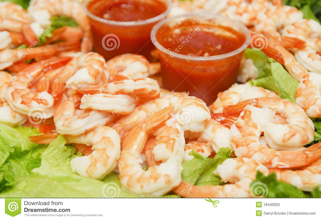 Shrimp and Cocktail Sauce on Lettuce