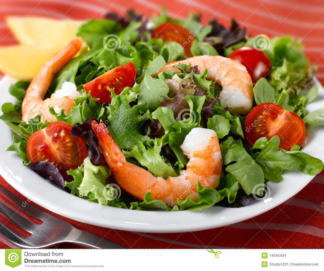 Fresh Leafy Green Salad with Jumbo Shrimp and Tomatoes.