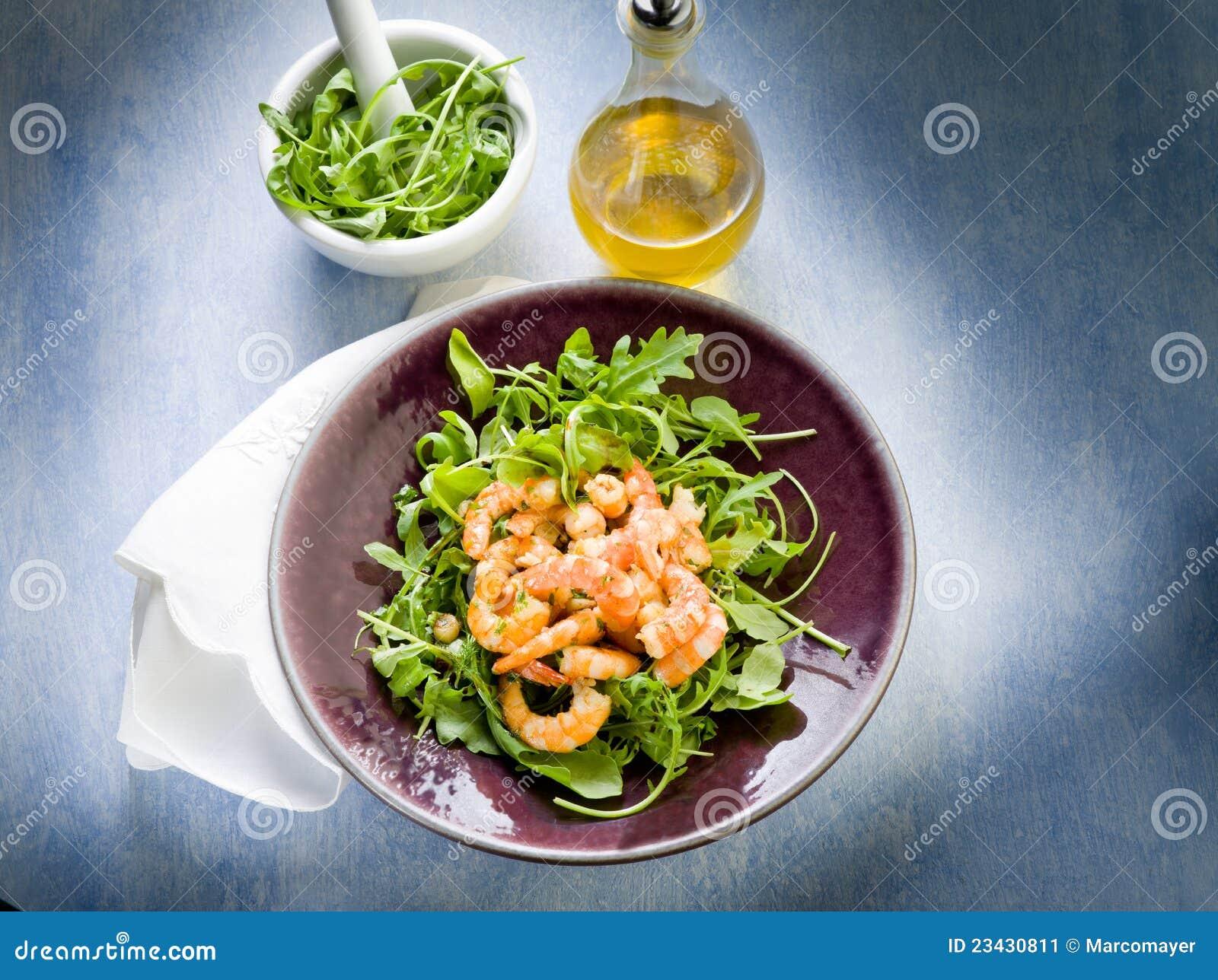 Shrimp salad with arugula olive oil and balsamic vinegar.