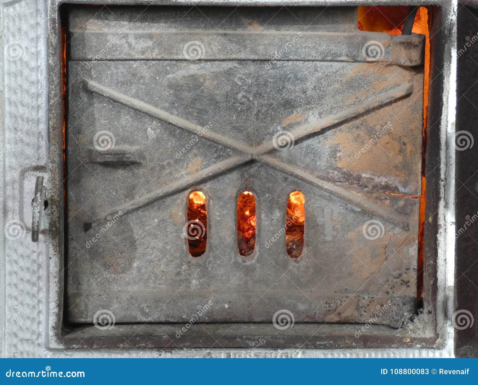 Shutter of Old Tile Stove - Fire Inside