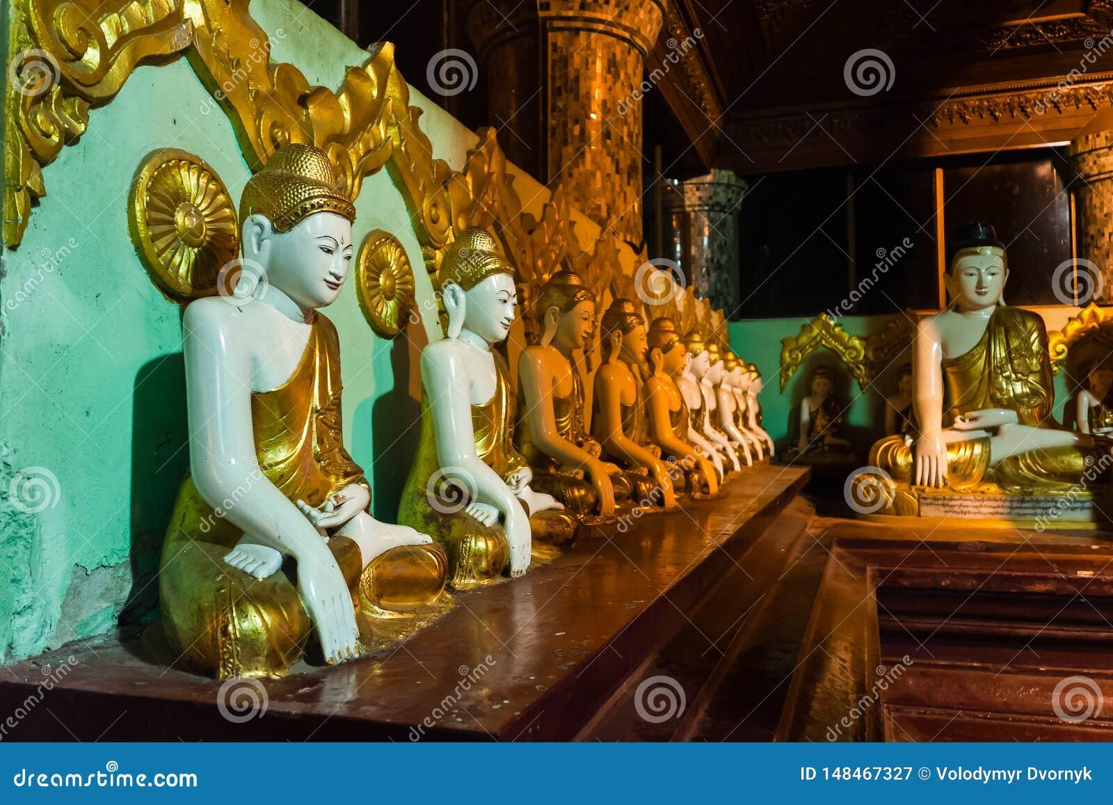 The Seated Buddha Statues In The Shwedagon Pagoda, Yangon, Myanmar