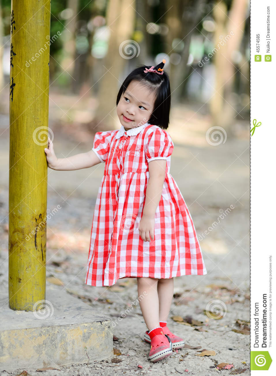 Shy Asian Girl In The Park Outdoor. Stock Photo - Image ...