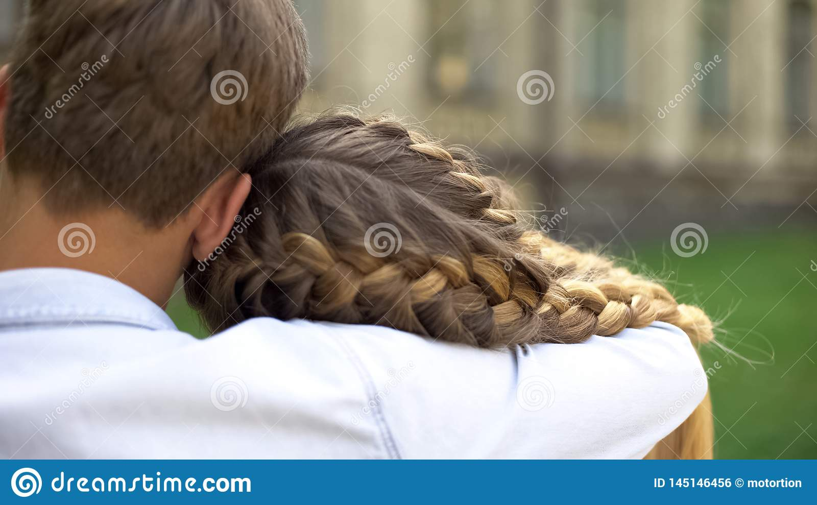 Shy Couple Of Teenagers Embracing Each Other First Love Tender Relationship Stock Photo Image Of Hold Flirting 145146456