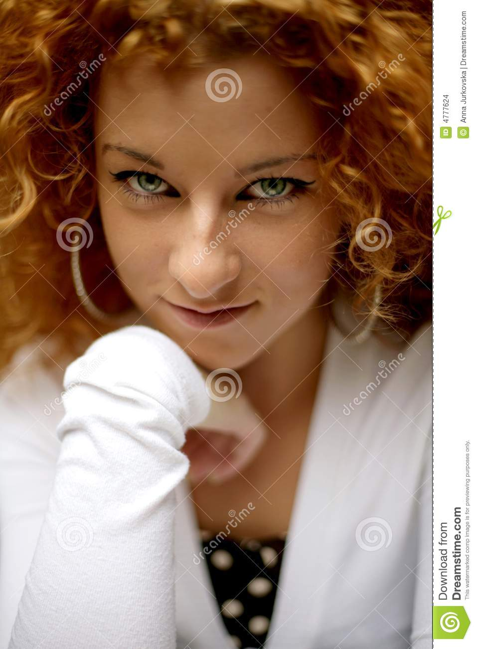Shy happy young woman looking