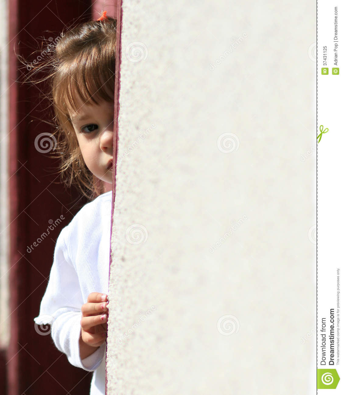 Shy Young Child Hiding...