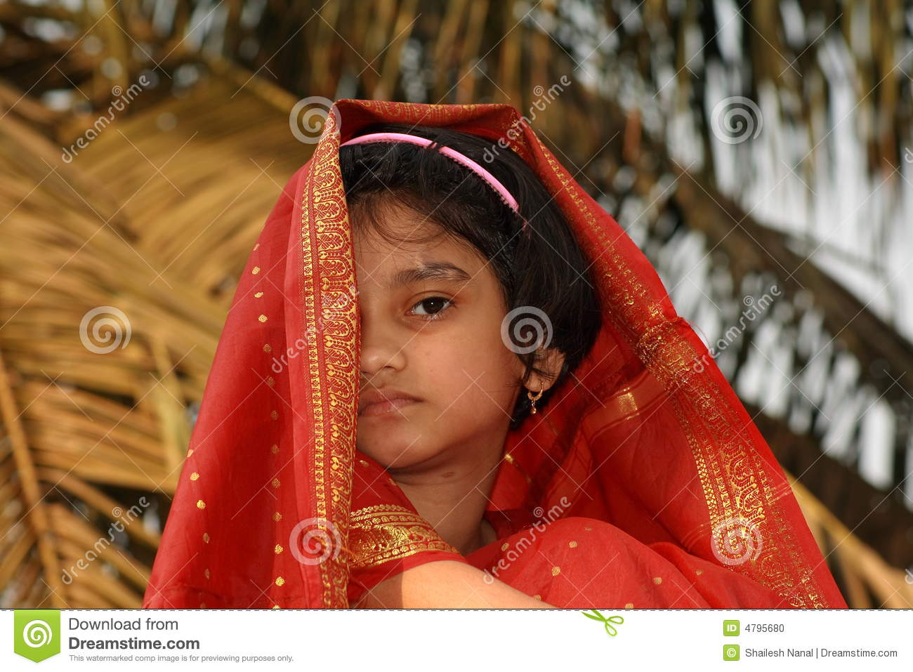 Shy Young Girl In Red Sari Stock Photo - Image: 4795680